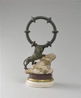 Statuette : Lion sur un rocher