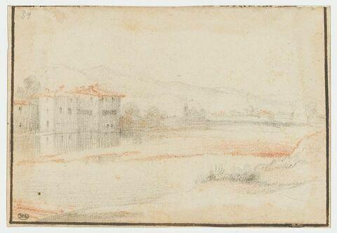 Paysage avec maisons au bord d'une rivière