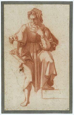 Jeune homme tenant une tablette