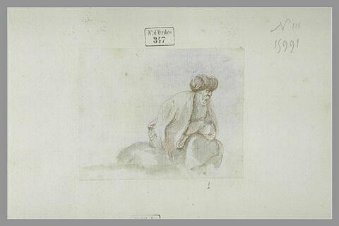 Vieillard, coiffé d'un turban, assis, tourné vers la droite