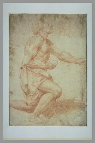 Homme à demi nu, à genoux, une pierre à la main ; esquisse d'un profil