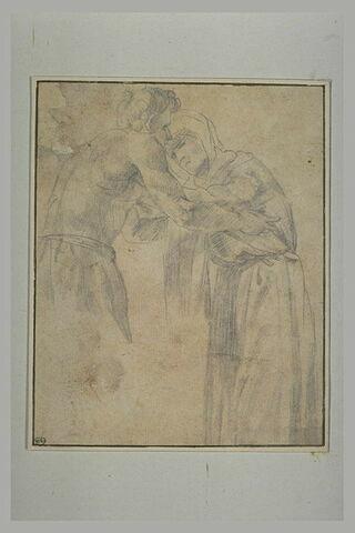 Un jeune homme recevant dans ses bras une vieille femme