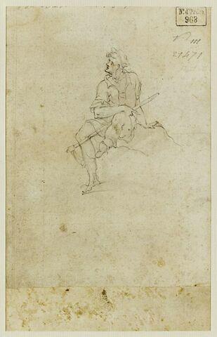 Homme assis, tenant un bâton
