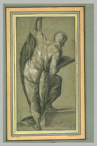 Un prophète s'appuyant sur un bâton et lisant un livre