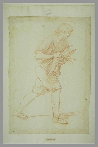 Jeune homme marchant vers la droite, portant un fagot (une brassée de paille?)