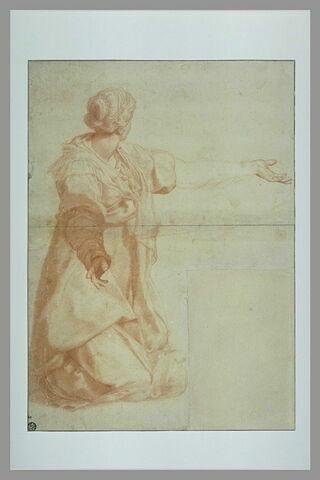 Femme drapée, agenouillée, le bras gauche tendu, la tête tournée à gauche