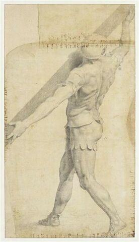 Soldat vêtu d'une cotte d'armes soutenant le bois de la croix