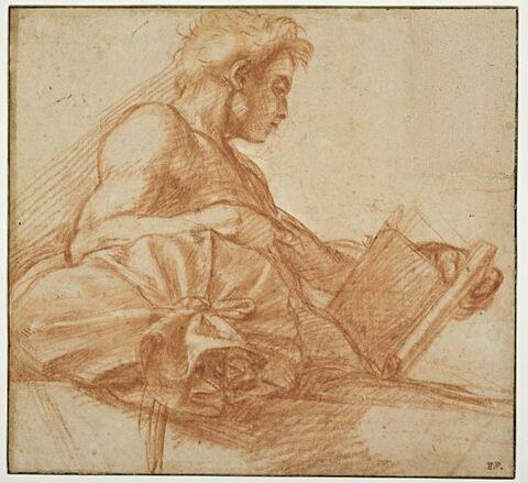 Jeune homme appuyé sur un coussin, de profil, lisant