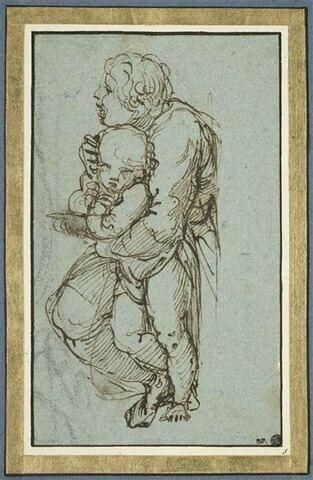 Figure agenouillée tenant un enfant