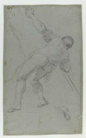 Homme s'appuyant sur une longue perche tenue à deux mains