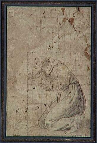 Saint François à genoux, en prières devant un crucifix