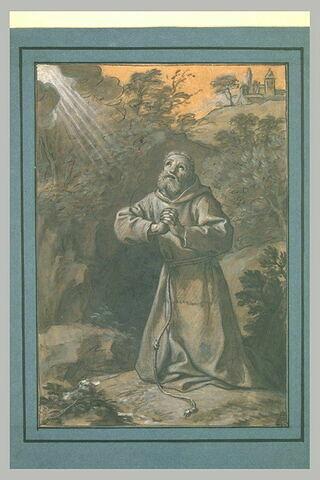 Religieux franciscain en prière dans un paysage
