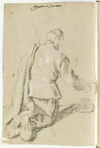 Homme à genoux vu de dos