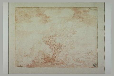 Paysans assis au pied d'un buisson, dans un paysage montagneux