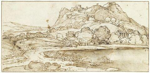 Petite montagne dans une plaine, avec un château-fort