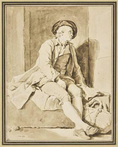 Homme assis sur une pierre