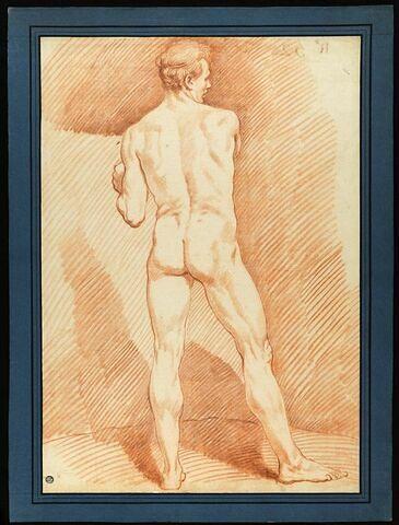 Homme nu, debout, vu de dos : un lutteur