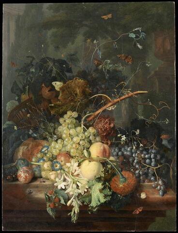 Fruits et fleurs avec corbeille renversée sur fond de parc