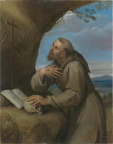 Saint François d'Assise en oraison devant un crucifix