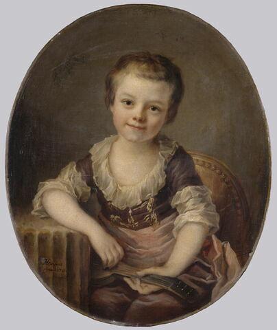 Portrait d'enfant jouant de la guitare