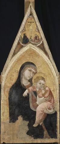 La Vierge et l'Enfant ; dans le médaillon trilobé à l'intérieur du gâble, Le Calvaire