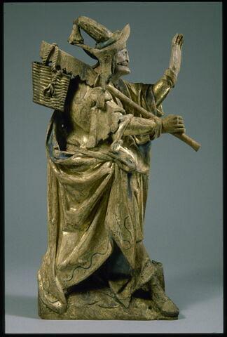 Personnage portant les outils de la Crucifixion