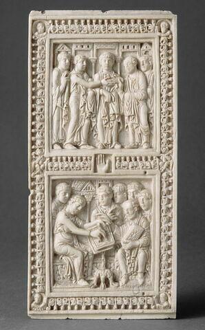 Plaque de reliure du psautier de Dagulf : Saint Jérôme corrigeant le texte des Psaumes.