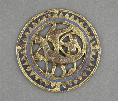 Médaillon ajouré d'un ensemble de 12 provenant d'un coffret : oiseau fantastique. Bordure de dents de scie.