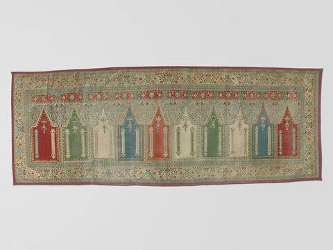 Tapis d'Orient motifs à fond rouges, gris, verts.