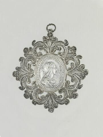 Médaillon, à deux faces serti en filigrane