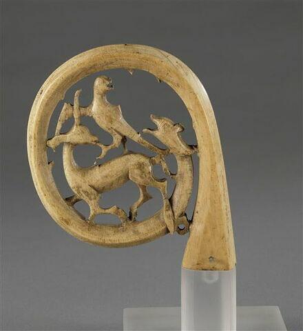 Crosseron : Serpent et faucon attaquant une gazelle