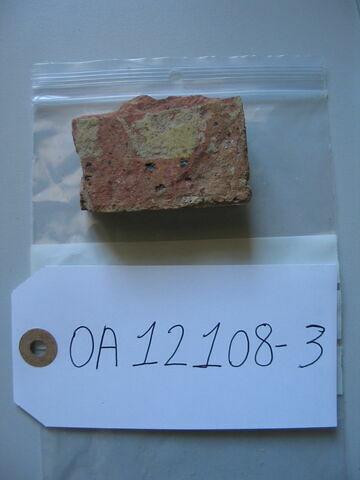 Fragment de carreau de pavage : fleur de lis (?)