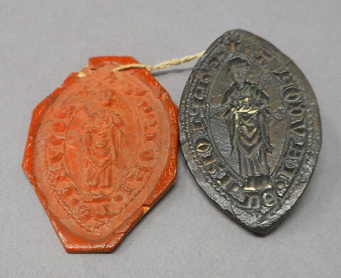 Matrice de sceau d'un prieur de jaucourt avec son empreinte de cire rouge