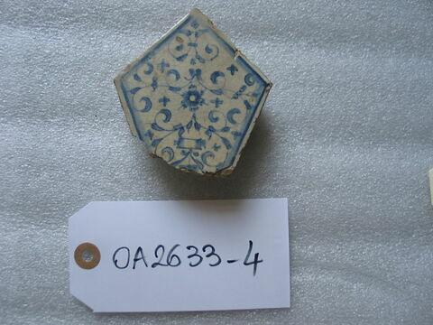 Fragment de carreau polygonal