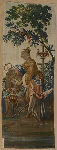 Panneau à décor chinois : Femme avec un oiseau