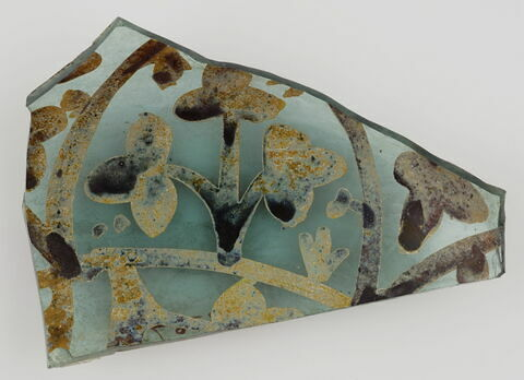 Fragment bleu avec décor floral marron