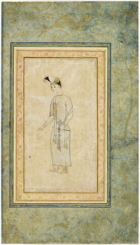 Jeune indien vêtu d'une robe et tenant un fuseau (page d'album)