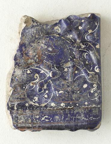 Fragment de carreau de revêtement au quadrupède