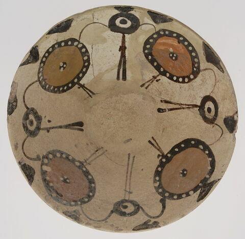 Coupe à motif floral et cercles ponctués