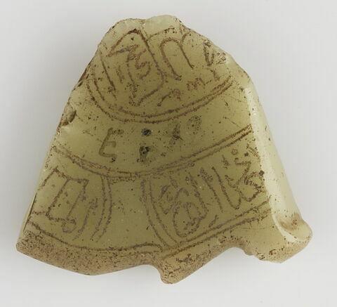 Fragment discoïdal d'amulette