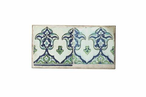 Panneau de bordure aux fleurons monumentaux et imbriqués