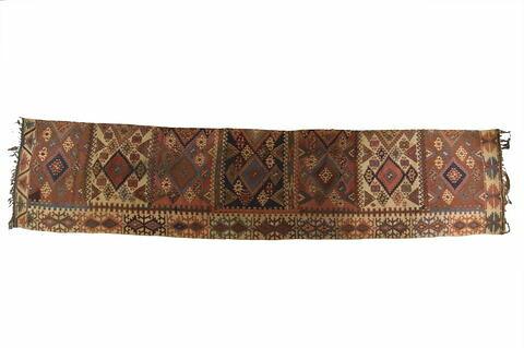 Moitié de kilim à compartiments meublés de médaillons losangés