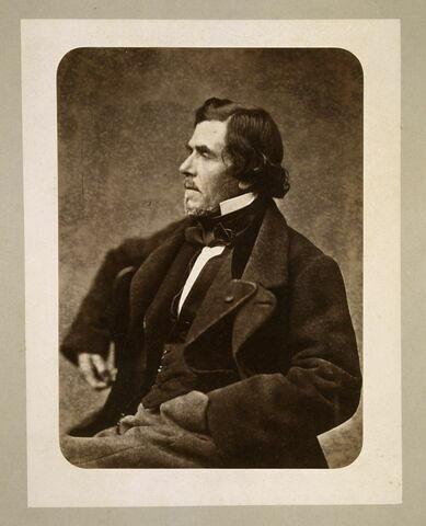 Portrait de Delacroix assis, la main gauche dans la poche du pantalon