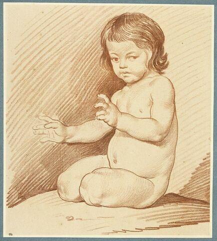 Enfant nu, assis par terre