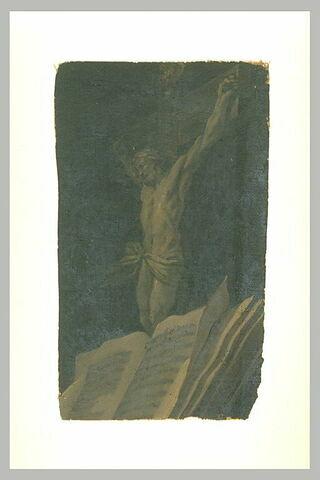 Crucifix derrière un livre ouvert