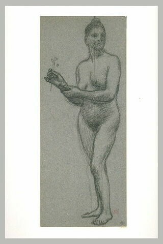 Femme nue debout de troit quarts à gauche tenant une fleur de la main droite