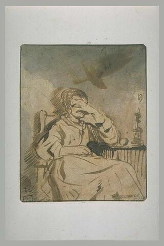 Femme assise à une table et abritant ses yeux de la flamme d'une bougie