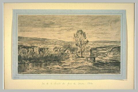 Hameau au bord d'un ruisseau