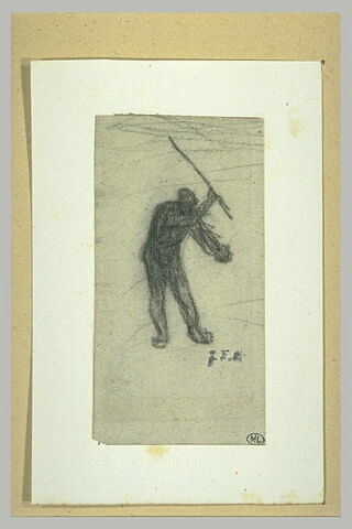 Homme brandissant un bâton