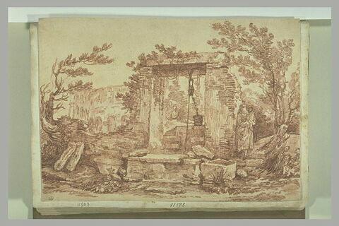 Au bord d'un puits proche de ruines antiques, une femme et un enfant